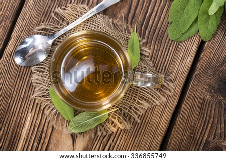 Cup of Tea (Sage) on vintage wooden background - stock photo