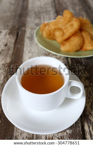 Cup of tea white porcelain and cookies