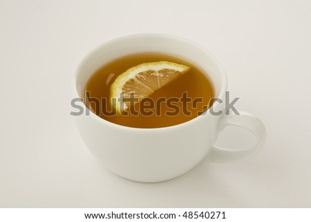 Cup of tea with a slice of lemon isolated on white - stock photo