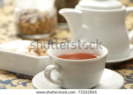 cup of tea with a teapot - stock photo