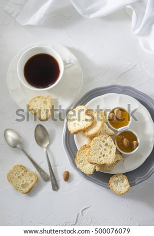 Cup of tea with biscuits and apricot jam on the white table . Top view