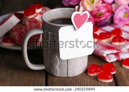 Cup of tea with card on table close-up - stock photo