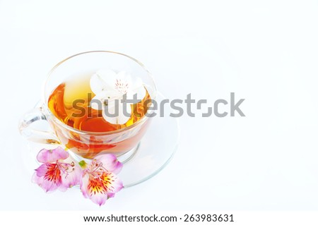 cup of tea with chamomile flowers on rustic wooden background - stock photo