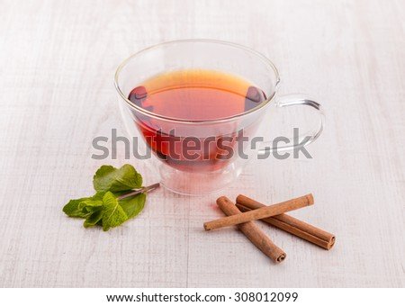 Cup of tea with cinnamon and mint. - stock photo