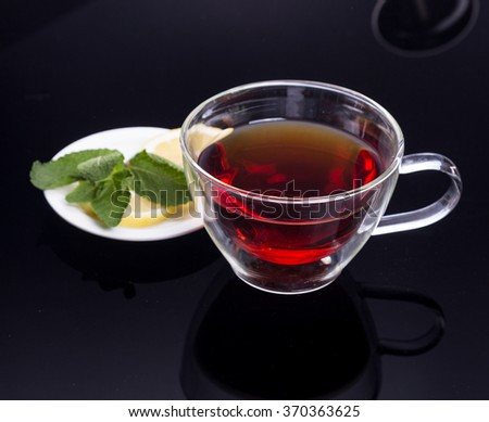 Cup of tea with cinnamon and mint - stock photo