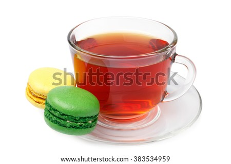 Cup of tea with colorful french macaroons on white background - stock photo