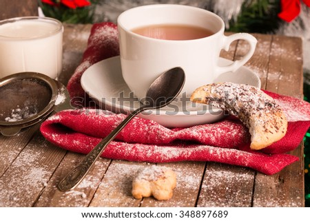 Cup of Tea with Cookies over Christmas background. Homemade Cookies. Selective Focus. - stock photo