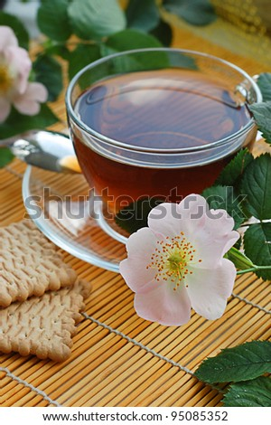 Cup of tea with dog-rose blossom