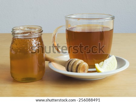 Cup of tea with honey and lemon - stock photo