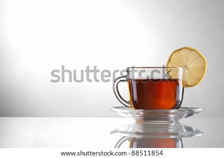 Cup of tea with lemon - stock photo