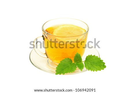 Cup of tea with lemon and lemon balm isolated on  white - stock photo