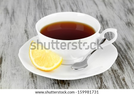 Cup of tea with lemon on table close-up - stock photo