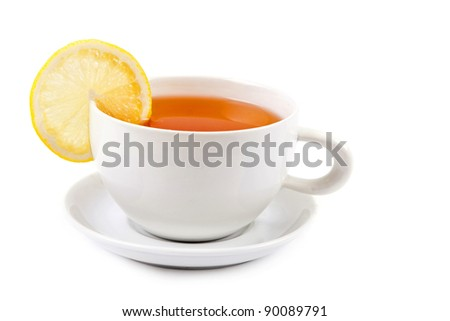 Cup of tea with lemon slice - stock photo