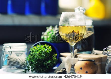 cup of tea with linden on wooden table on nature background - stock photo