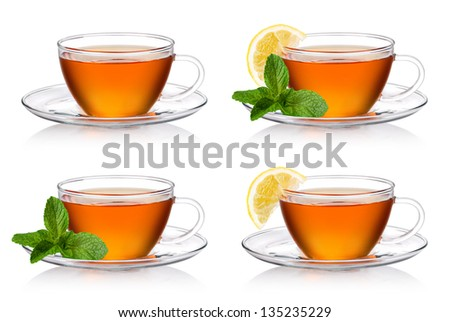 Cup of tea with mint and lemon on a white background - stock photo