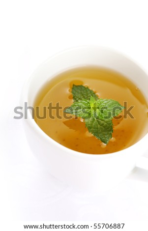 cup of tea with peppermint on white isolated background