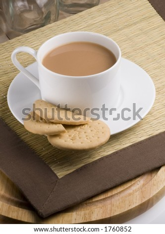 Cup of tea with rich tea biscuits - stock photo