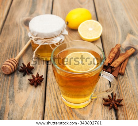 Cup of tea with spaces and honey on a wooden background - stock photo