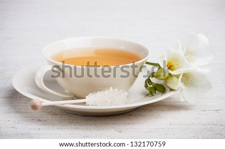Cup of tea with spring flower