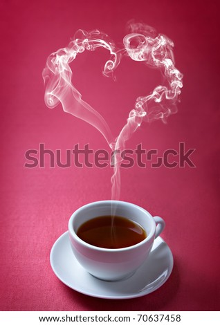 cup of tea with steam in a heart shape - stock photo
