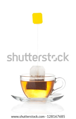 Cup of tea with tea bag (blank label) inside isolated on white background