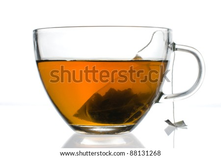 Cup of tea with tea bag inside on a white background - stock photo