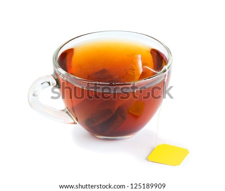 Cup of tea with teabag on white background - stock photo