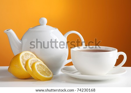 Cup of tea with teapot - stock photo
