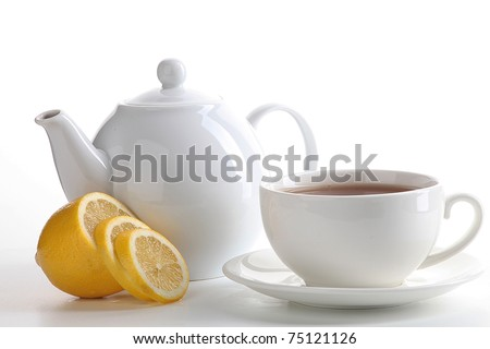Cup of tea with teapot and lemon - stock photo