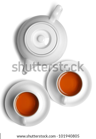 Cup of tea with teapot isolated on white. - stock photo
