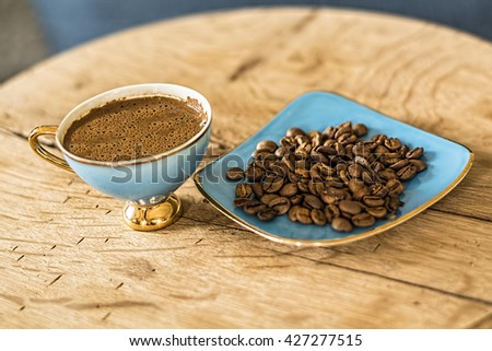 Cup Of Turkish Coffee with coffee beans on wooden background.  - stock photo