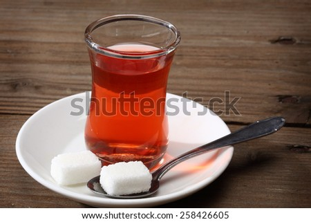 Cup of Turkish tea and sugar lumps - stock photo