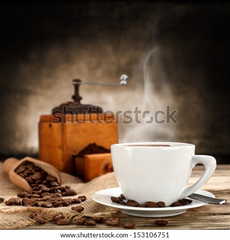 cup of warm coffee and coffee grinder  - stock photo