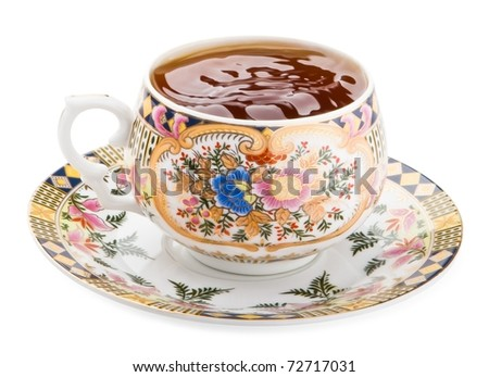 Cup of waving tea isolated on white - stock photo