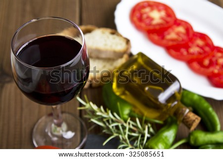 cup of wine with oil and peppers - stock photo