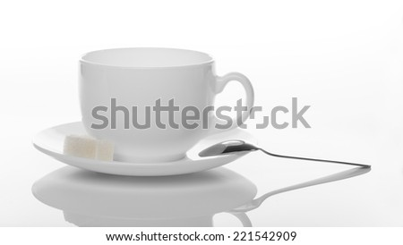 cup of  with  sugar and spoon, isolated on white background - stock photo
