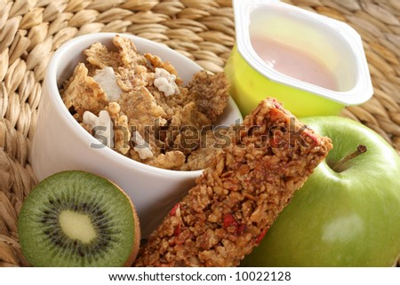 cup of yogurt green apple and cereals - stock photo
