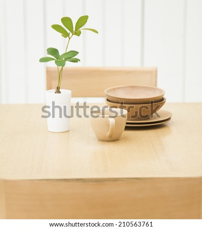 cup on the kitchen table - stock photo