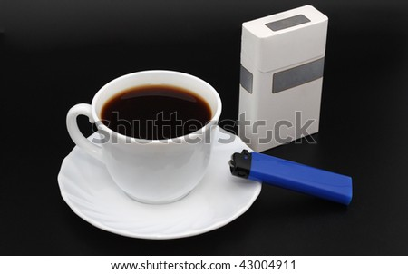 Cup os coffee. Cigarettes and lighter. Black background - stock photo