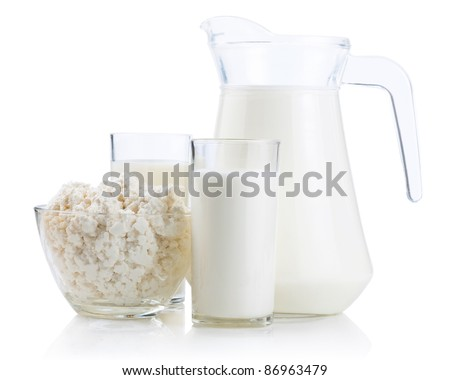 Cup serving of Cottage Cheese, two glasses and Jug of fresh milk Isolated on White Background