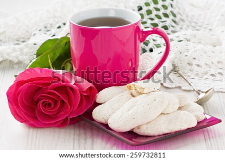 Cup tea with almond cookies and rose   - stock photo