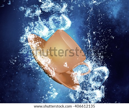 Cup under water - stock photo