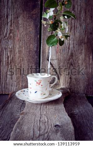 cup with a saucer on a wooden background - stock photo