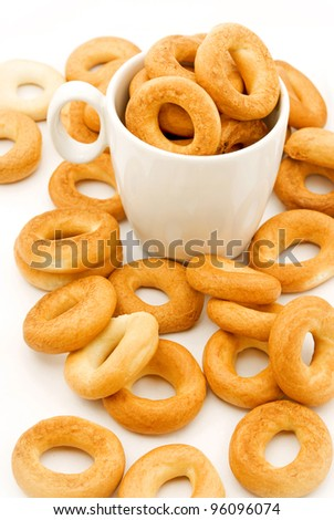 cup with bagels, picture on a white background - stock photo