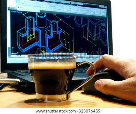 cup with black coffee at designer workplace