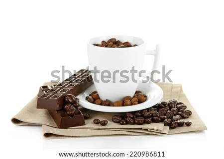 Cup with coffee beans and dark chocolate glaze, isolated on white - stock photo