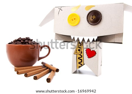 Cup with coffee beans; cigarettes and insane cardboard addict - stock photo