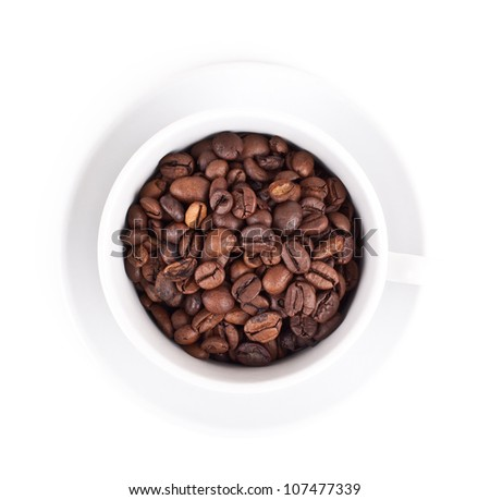 cup with coffee beans on white background