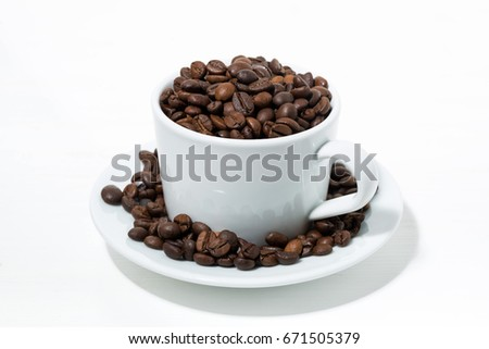 cup with coffee beans on white background, closeup horizontal