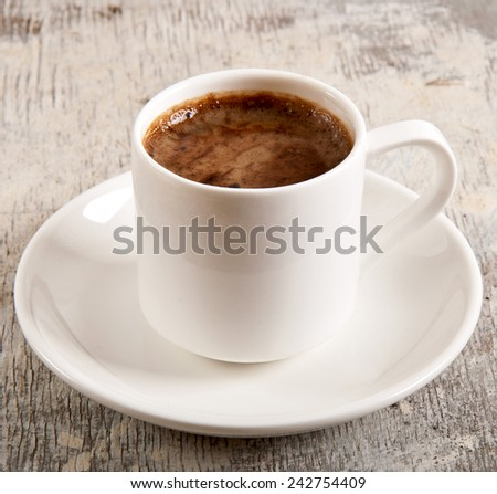 cup with coffee, breakfast coffee, a cup of coffee on old wooden table - stock photo